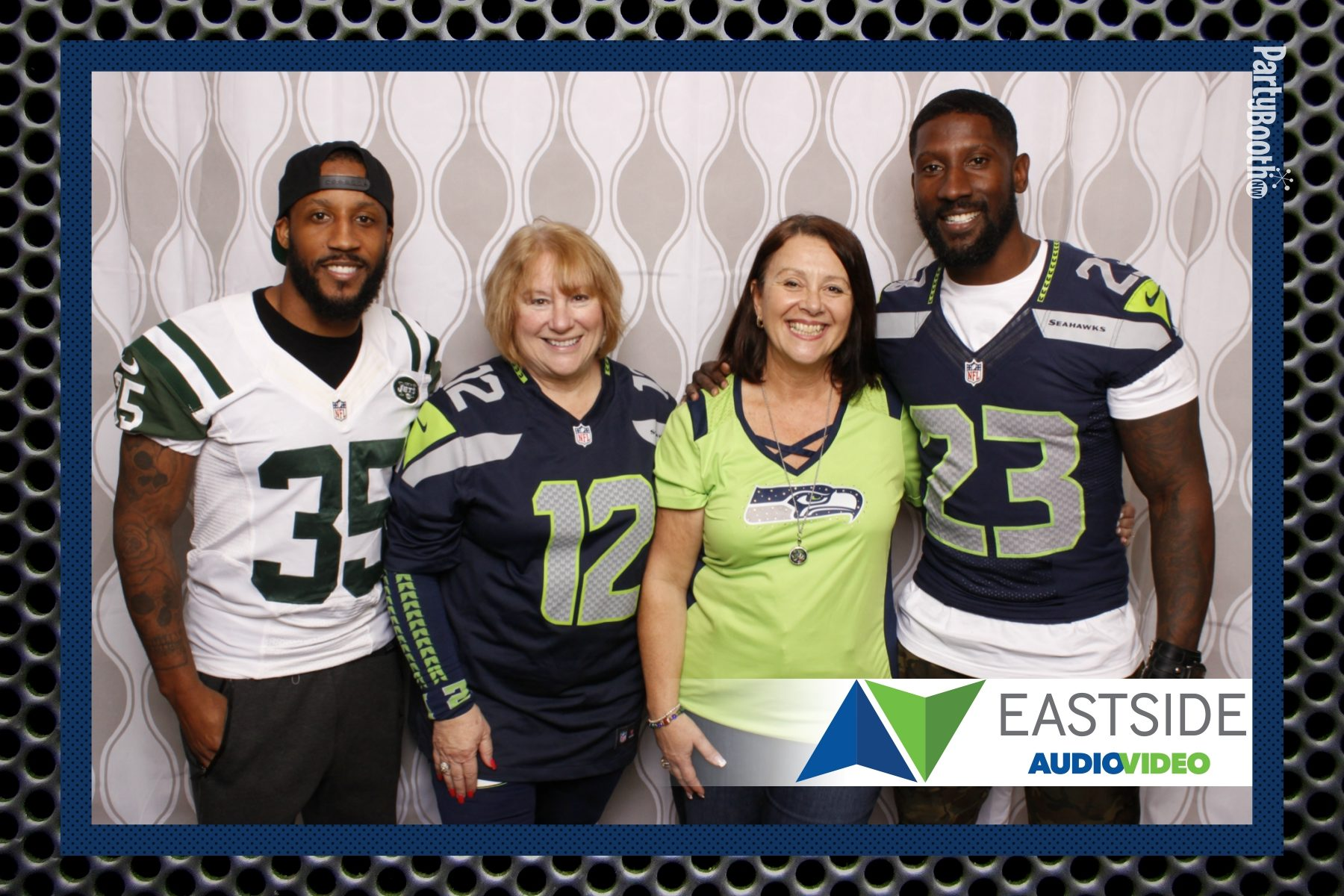 Eastside AV - The Premier Home Theater Installation Company in the NW - hosted their customers, clients, friends and family in their new showroom facility in Bellevue, WA to see the latest in AV and Home Theater technology, and to watch the Seattle Seahawks game on the big screen! Seattle Photo Booth © 2016 PartyBoothNW.com